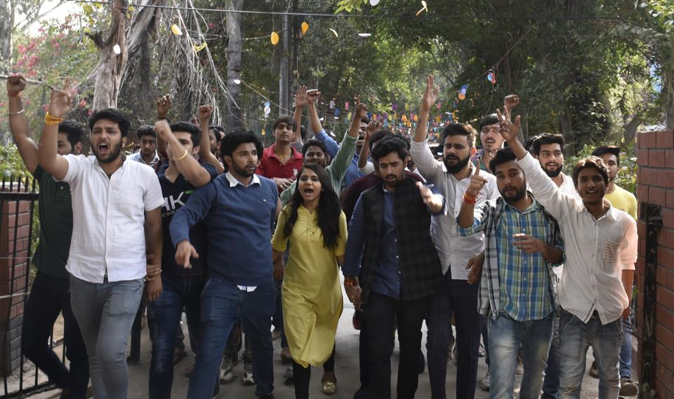 The students and members of Akhil Bharatiya Vidyarthi Parishad (ABVP) shouting slogans at  Ramjas College in New Delhi, India.