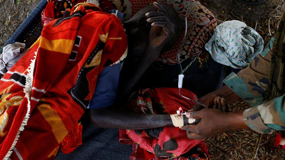 A sick man is treated by a United Nations Mission in South Sudan peacekeeper during a foot patrol near Bentiu. (REUTERS Photo)