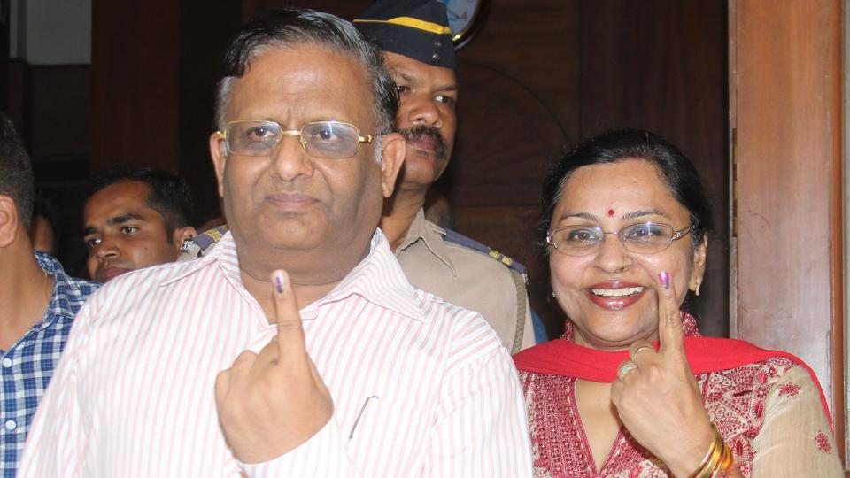 State election commissioner JS Saharia with his wife at a booth at KC College.  (bhushan koyande)