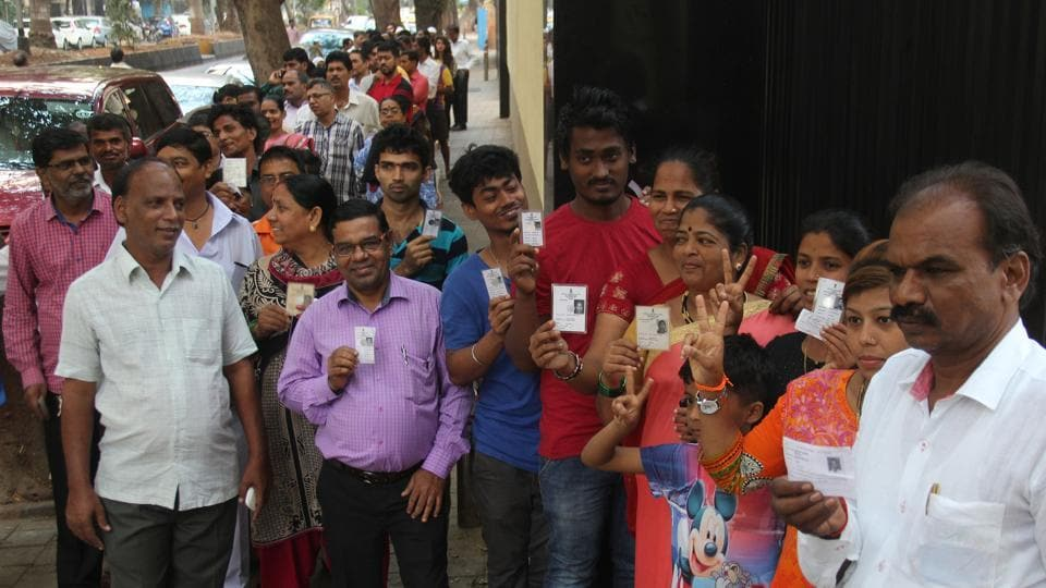 People wait in line to cast their vote outside a polling booth at Cuff Parade in Mumbai on Tuesday.