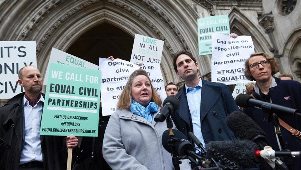 Rebecca Steinfeld (centre left), and her partner Charles Keidan (centre right), address the media in London on February 21, 2017 after they lost their case at the Court of Appeal for the right to enter into a civil partnership. Keidan and Steinfeld, both academics who live in London, argued that civil partnerships only being available to same sex couples was incompatible with equality law.