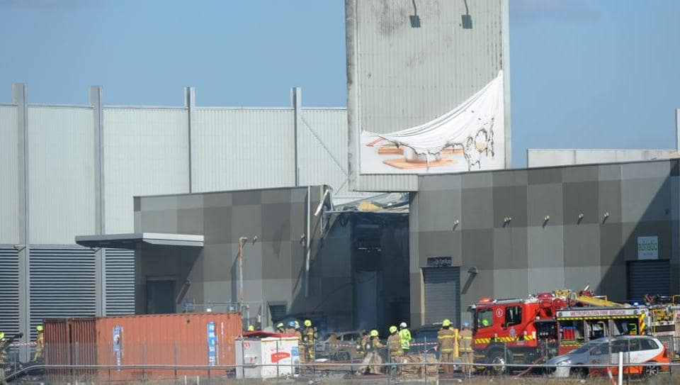 Fire crew at the scene where a light plane crashed into the back of a building at Essendon airport in Melbourne, Australia.