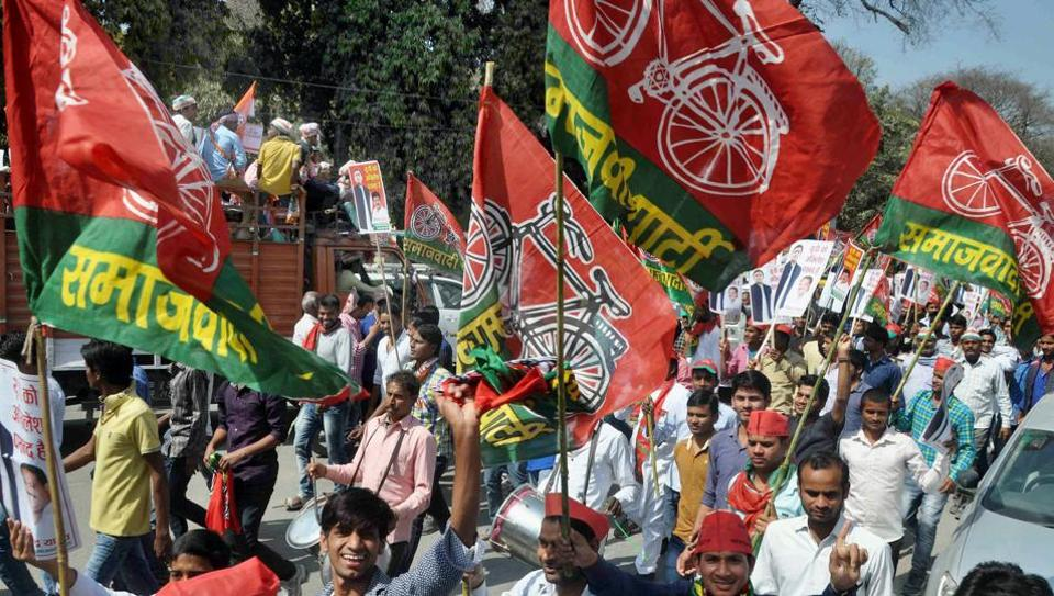 Supporters of Congress vice-president Rahul Gandhi and Uttar Pradesh chief minister Akhilesh Yadav during a road show campaign for Congress-SP alliance for the UP election, in Allahabad on Tuesday.