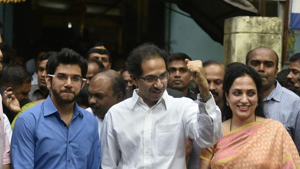 Shiv Sena president Uddhav Thackeray with his family outside a polling booth in Bandra. (Kunal Patil/HT PHOTO)