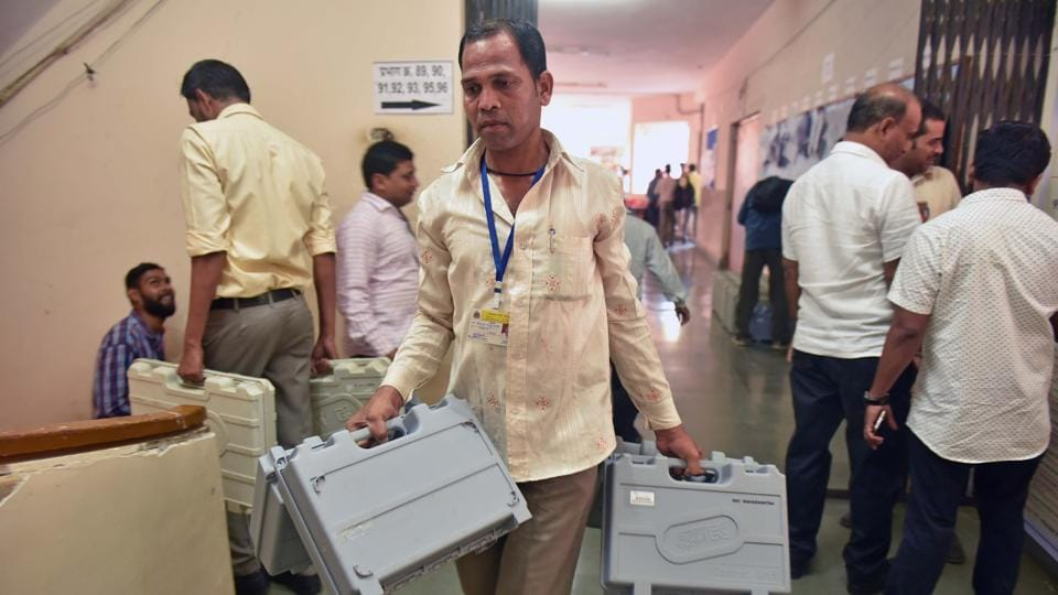 EVMs are distributed at a BMC office in Santacruz on Monday.