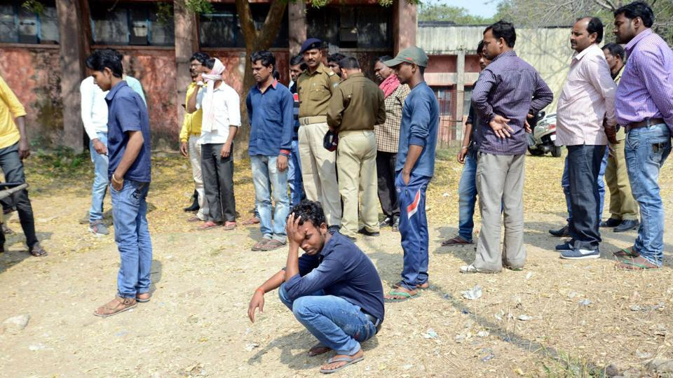 Onlookers and police personnels before the postmortem house of PMCH after BCCL employee poisoned himself and four members of his family in Dhanbad on Tuesday.