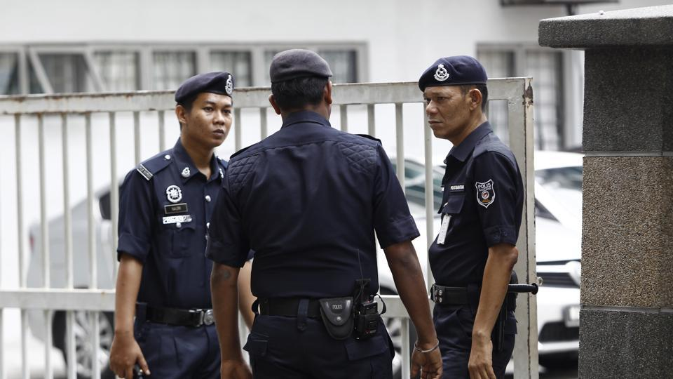 Police officers patrol outside the forensic department at Kuala Lumpur Hospital in Kuala Lumpur, Malaysia, Tuesday, Feb. 21, 2017. No cause of death has been determined yet for the exiled member of North Korea's ruling family, Kim Jong Nam, who died last week after apparently being poisoned in a Kuala Lumpur airport, officials said Tuesday.