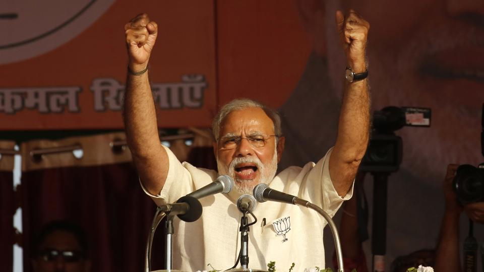 Prime Minister Narendra Modi gestures as he addresses an election rally in Allahabad, Uttar Pradesh.