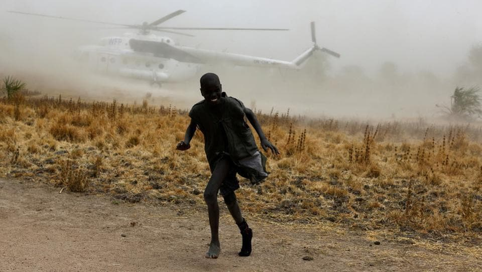 A boy moves away as a United Nations World Food Programme helicopter lands in Rubkuai village, Unity State, northern South Sudan. (REUTERS Photo)