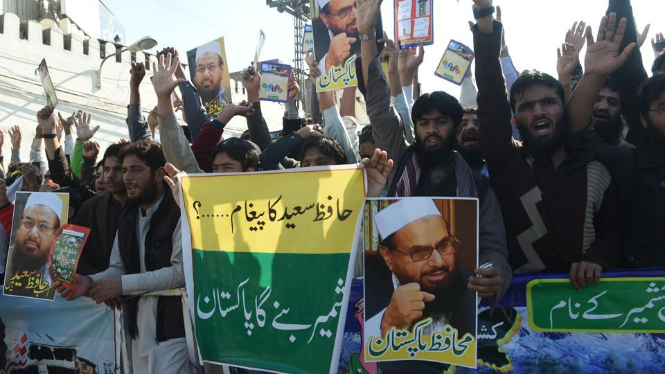 Pakistani supporters of the Jamaat-ud-Dawa (JuD) organisation shout slogans during a protest after JuD leader Hafiz Saeed was placed under house arrest by authorities in Lahore on February 10.