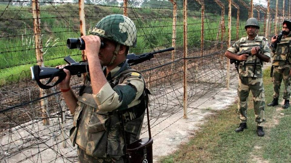 BSF personnel patrol along the India and Pakistan international border.