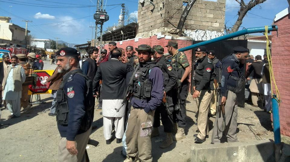 Pakistani security personnel gather at the main entrance of a court complex in Tangi area of Charsadda district after a group of suicide bombers attempted to storm it  on February 21, 2017. At least six people were killed and more than 20 injured in the assault, the latest in a wave of terror attacks which has raised fears that militants are regrouping.
