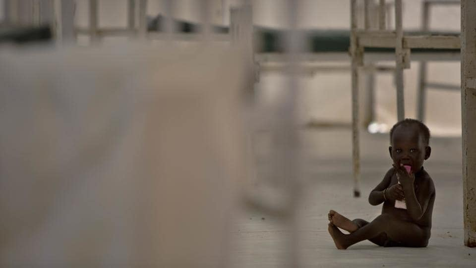 A young child sits on the floor in the therapeutic feeding unit of the medicines Sans Frontieres (Doctors Without Borders) hospital. (AP Photo)