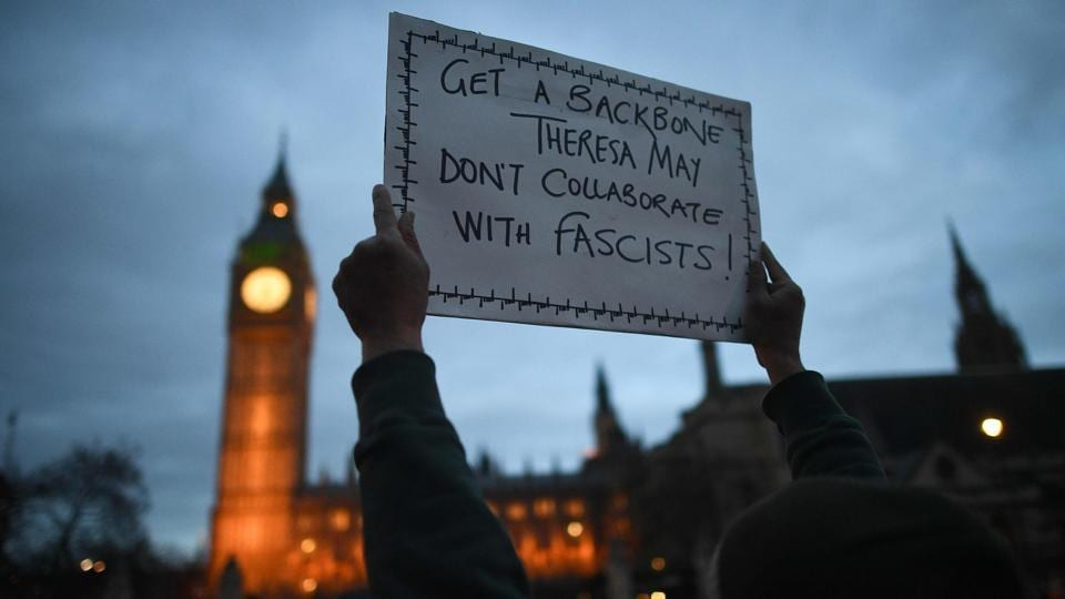 A protestor holds a placard near the Houses of Parliament during an anti-Trump protest in London on February 20, 2017.