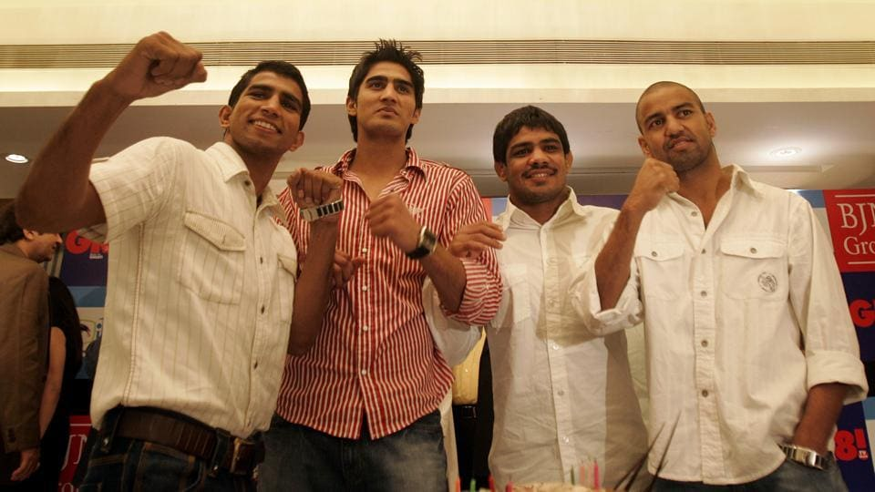 After Vijender Singh (2nd from left),  Jitender Kumar (extreme left) and Akhil Kumar (extreme right) will turn pro boxers.