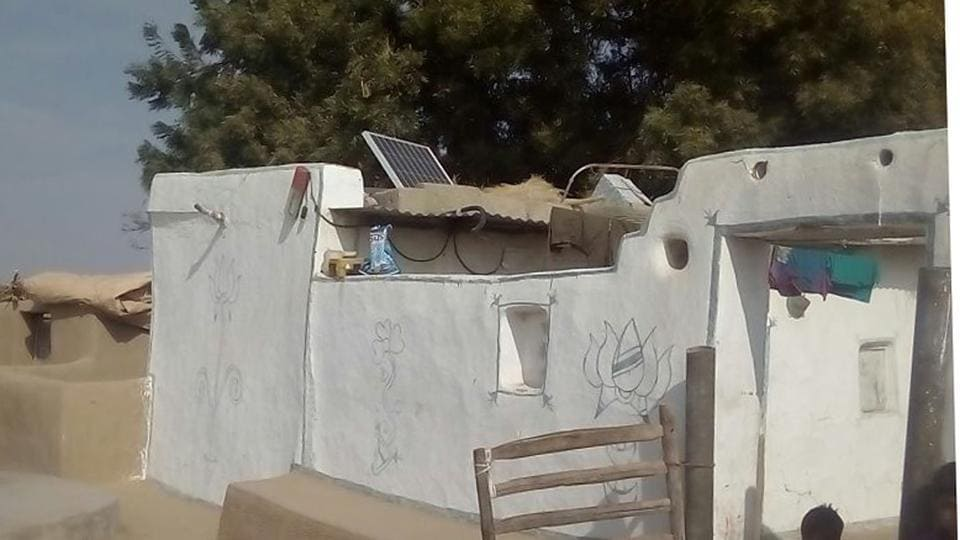 A hut with solar power panel in Barmer village.