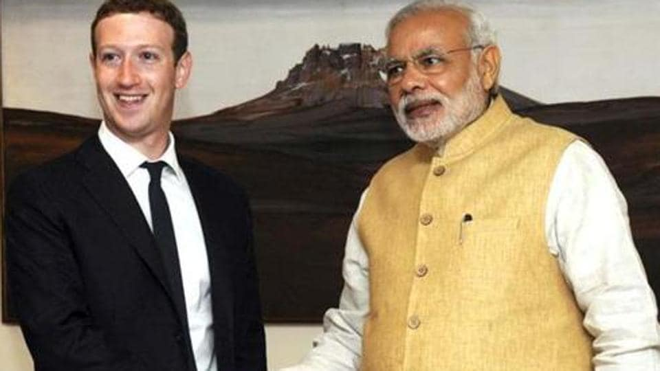 """File photo of Mark Zuckerberg (L), founder and CEO of Facebook, with Prime Minister Narendra Modi.  The Indian PM on Feb 21, 2017,urged the US to have a """"balanced and farsighted perspective"""" on the movement of skilled professionals."""