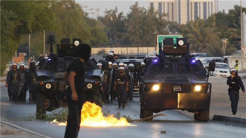 Bahraini police have arrested 20 people in a crackdown on Shia villages, as legislators approved a constitutional amendment that could see civilians tried in military courts in the Sunni-ruled kingdom.
