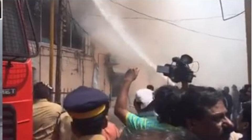 The fire reportedly broke out in a textile shop around 11:30 a.m., following which approximately 15 shops were gutted.