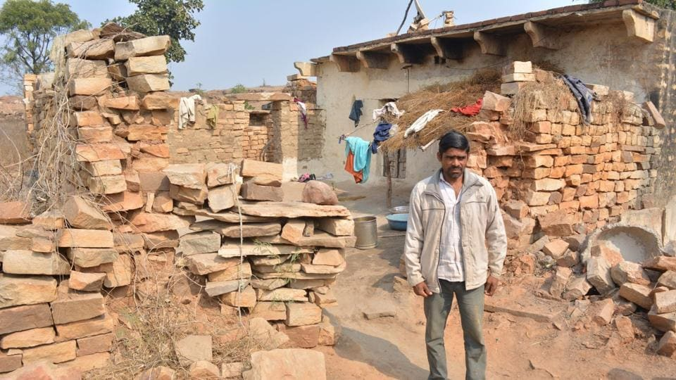 A resident of Cheepiya village showing the dilapidated condition of his house.