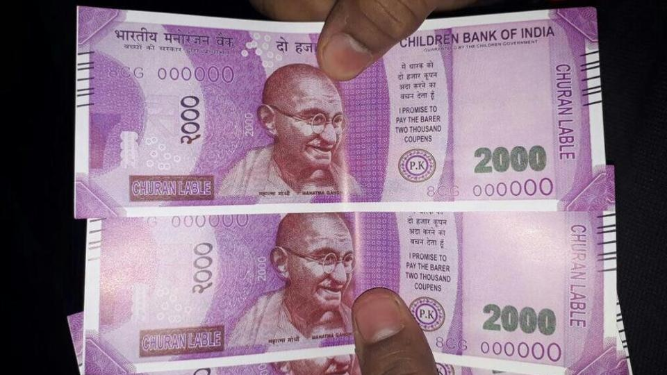 """The notes are labelled as """"Children Bank of India"""", """"Churan Label"""" and other funny wordings. Since people are not fully accustomed to the feel of the new notes, they can easily be befooled using these notes."""