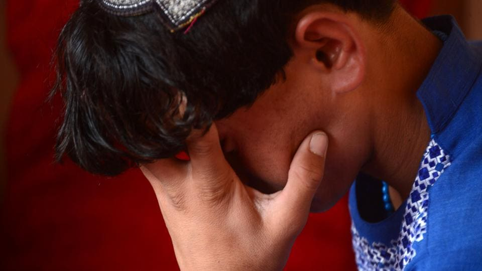 """Photograph taken on October 31, 2016 shows an Afghan boy who was held as a child sex slave. """"Bacha bazi"""" has been described as a hidden epidemic of kidnappings of young boys for institutionalised sexual slavery in Afghanistan."""