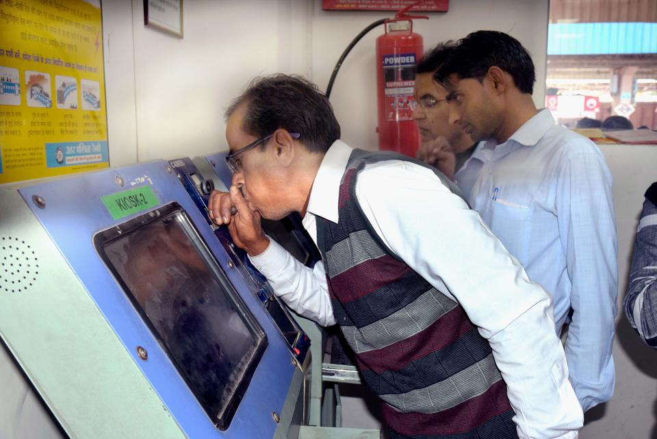 A railway employee uses breathalyser to mark attendance at Jaipur station.