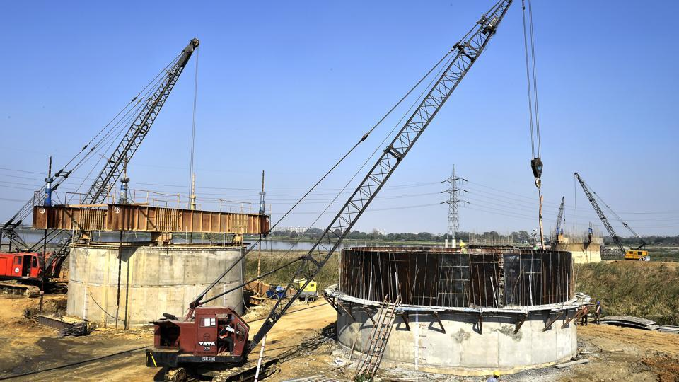 Construction work going on at the Barapullah elevated corridor, phase 3, from Sarai Kale Khan to Mayur Vihar in New Delhi.