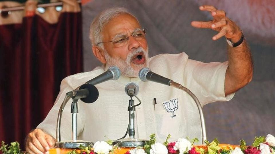 Prime Minister Narendra Modi gestures as he addresses an election campaign rally in Allahabad.