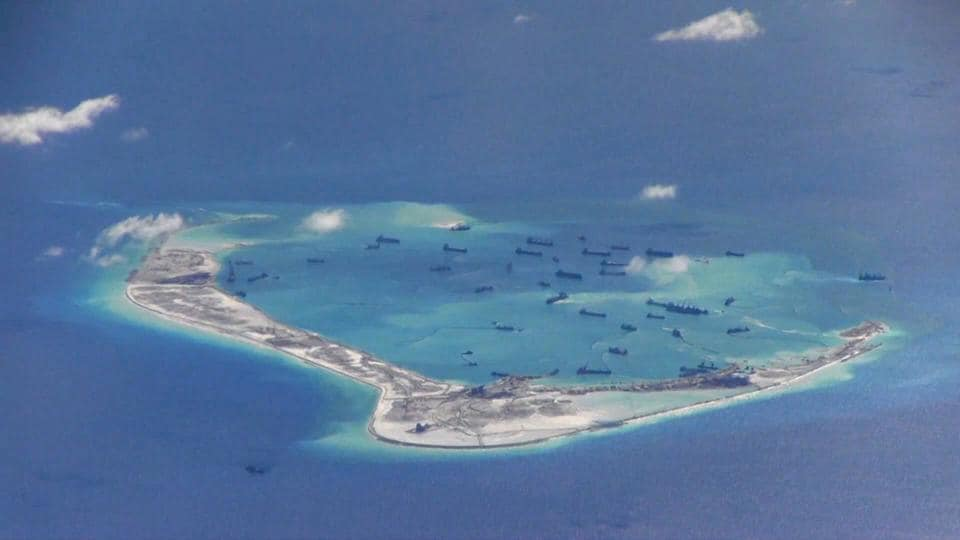 File photo of Chinese dredging vessels seen in waters around Mischief Reef in the disputed Spratly Islands in the South China Sea. This still image is from video taken by a P-8A Poseidon surveillance aircraft provided by the US Navy in 2015.