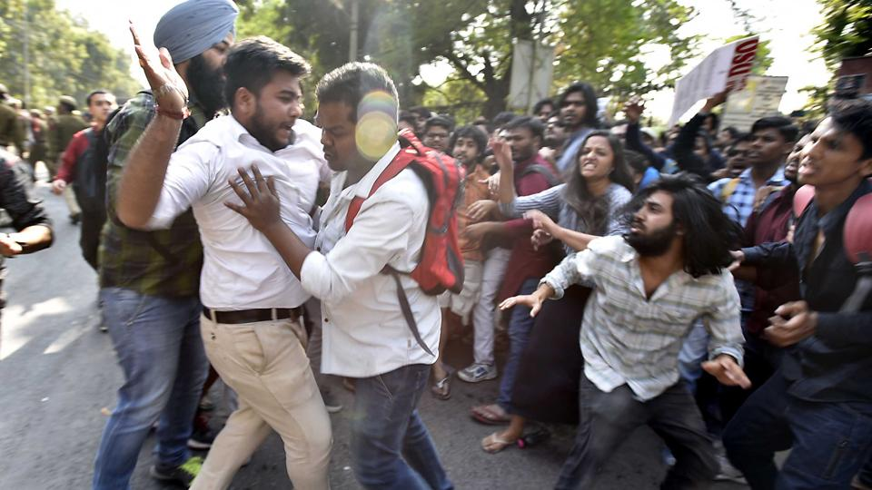 Rival factions grapple with each other at Delhi's Ramjas College, where students had gathered to protest against the Akhil Bharatiya Vidya Parishad.