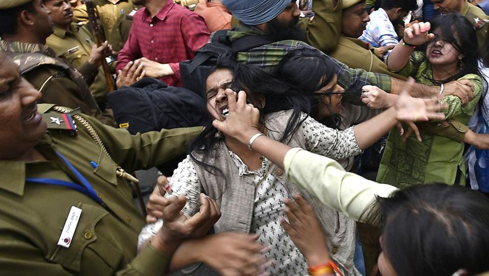 ABVP and AISA members fight with each other after a scuffle broke out between them. (Raj K Raj/HT PHOTO)