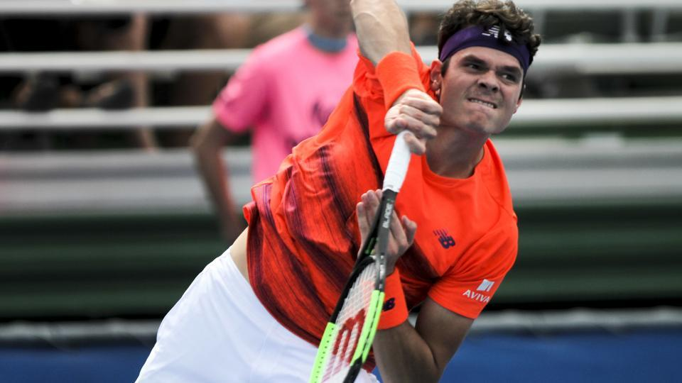 Milos Raonic serves to Tim Smyczek during the Delray Beach Open at the ATP Delray Beach Open.