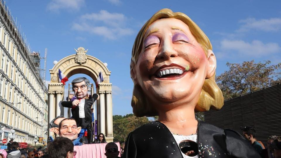 A float depicting French presidential election candidate for the far-right Front National (FN) party Marine Le Pen (R), candidate for the left-wing French Socialist (PS) party Benoit Hamon and candidate for the right-wing Les Republicains (LR) party Francois Fillon (back) parade in the streets of Nice  (VALERY HACHE / AFP)