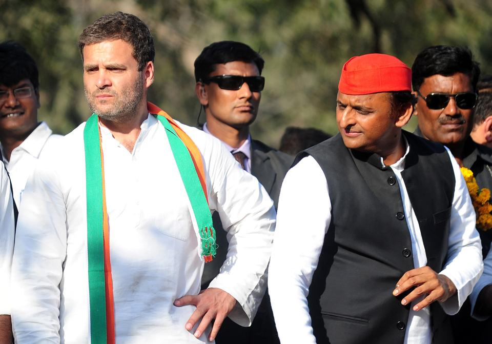 Chief Minister of Uttar Pradesh and Samajwadi Party leader Akhilesh Yadav (Right) and Congress Party vice-President Rahul Gandhi (Left) speak as they take part in a joint roadshow in support of their state assembly election party candidates in Allahabad on February 21.