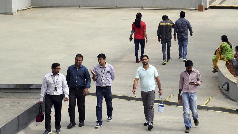 In this January 18 file photo, Wipro Ltd. employees walk inside the company's compound during a break at their headquarters in Bangalore.