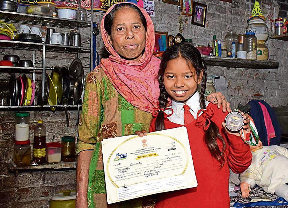 Sharmila, along with her mother Sonia, showing the bronze medal and certificate that she won at nationallevel judo championship (Khelo India) organised by the ministry of youth affairs and sports held at Jaipur, in Jalandhar on Wednesday.