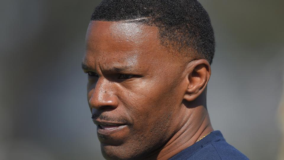 Croatian police have filed charges against two people who allegedly used a racial slur to insult Hollywood actor Jamie Foxx in a restaurant.