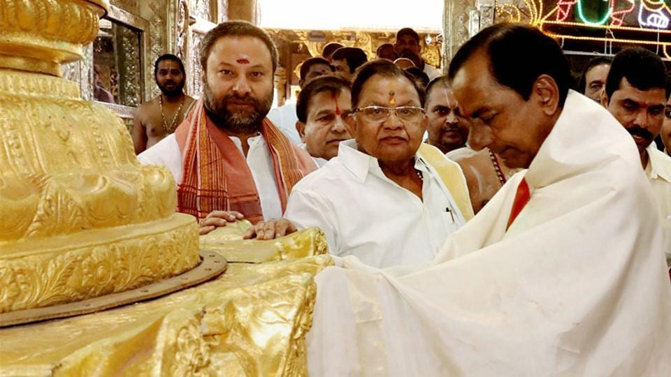 Telangana CM K Chandrasekhar Rao with TTD officials after donating ornaments worth Rs 5 crore at the golden holy flag mast of the temple of Lord Venkateswara at Tirumala in Tirupati on Wednesday.