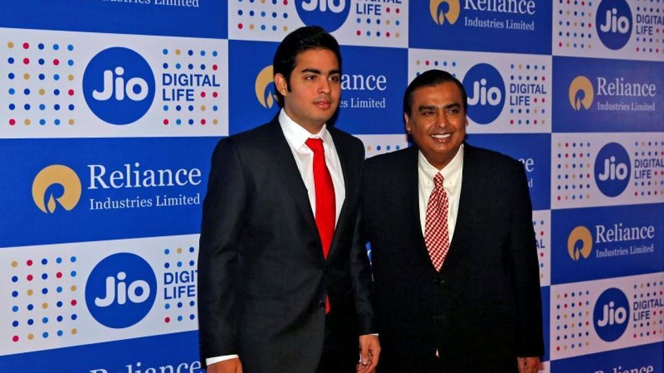 Mukesh Ambani chairman of Reliance Industries Ltd, poses with his son Akash before addressing the company's annual general meeting in Mumbai.