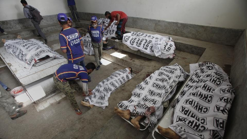 Bodies of alleged militants killed in an operation by security forces are tended to by workers form the Chhipa Welfare Association, at a mortuary, in Karachi, Pakistan, Wednesday, Feb. 22, 2017. Rao Anwar, a police official in Karachi, said eight Taliban-linked militants were killed in the raid. Pakistan said it will send paramilitary forces to crack down on Islamic militants in the Punjab province, a move that the ruling party of Prime Minister Nawaz Sharif had long rejected because of opposition among his Islamist supporters. (AP Photo/Fareed Khan)