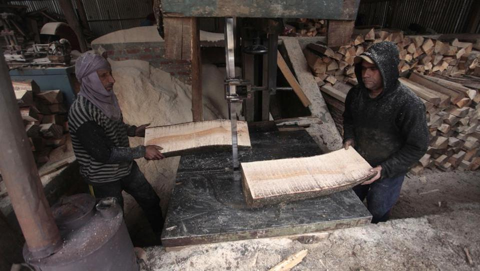 Workers at the factory  turn the willows - known as clefts - into finished articles suitable for playing. (Waseem Andrabi  / HT Photo)