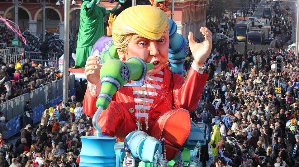 People look at the float 'Wind of Change' depicting US President Donald Trump as it parades for the 133rd edition of the Nice Carnival in Nice, southeastern France. The Nice carnival runs until February 25, 2017 under the theme