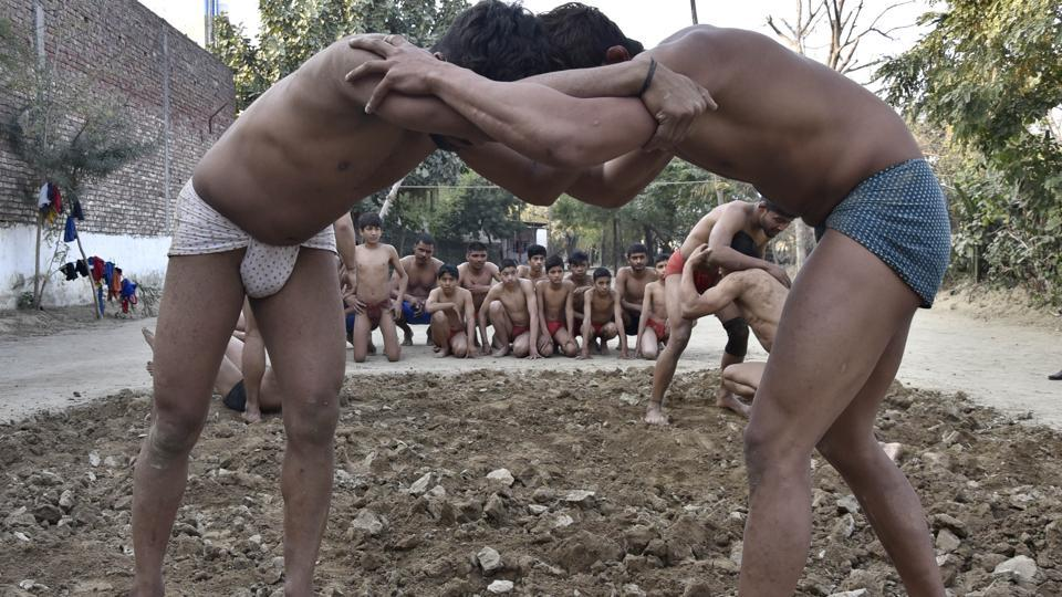'Kushti' in progress at Krishan Pehalwan Akhaara (P and T) facility in Amritsar on Wednesday. (Gurpreet Singh/HT Photo)