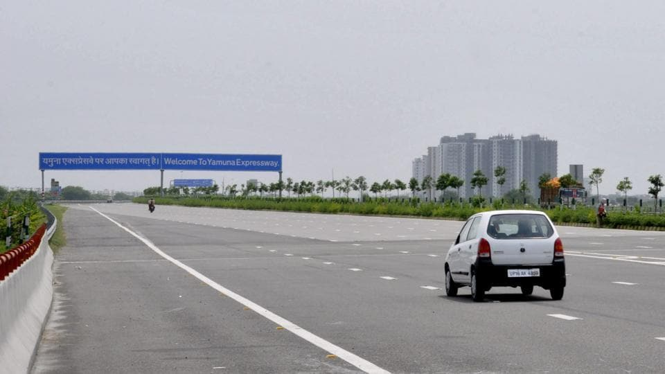 A woman was killed and two others critically injured when the car they were travelling in hit a road divider on the Yamuna Expressway early Wednesday morning.