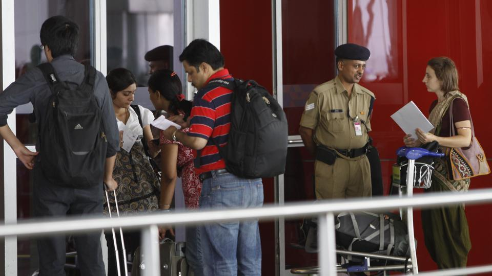 CISF officials at the Delhi airport. The country's airport security corps have objected to the immediate implementation of the civil ministry's plan to do away with hand baggage tags.