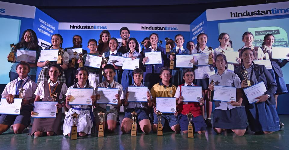 Actors Kriti Sanon and Sushant Singh Rajput with the 25 winners of the HT Scholarship programme, at Rangsharda Auditorium in Bandra on Wednesday.