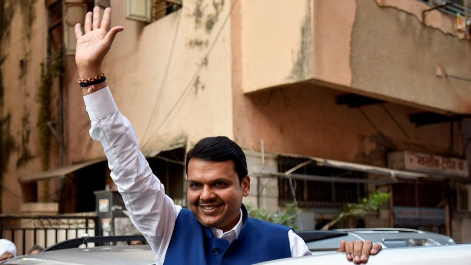 ONE FOR THE WAVE: Maharashtra CM Devendra Fadnavis arrives for a press conference at the BJP office in Dadar on Thursday. (Kunal Patil/HT photo)