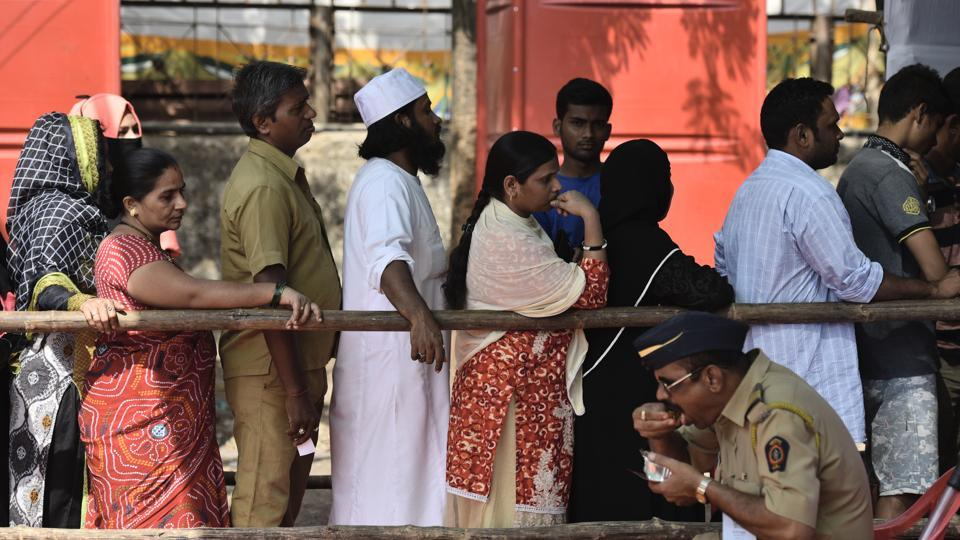 Mumbaiites queue up to cast their votes during the BMC polls at Shivaji Nagar on Tuesday.