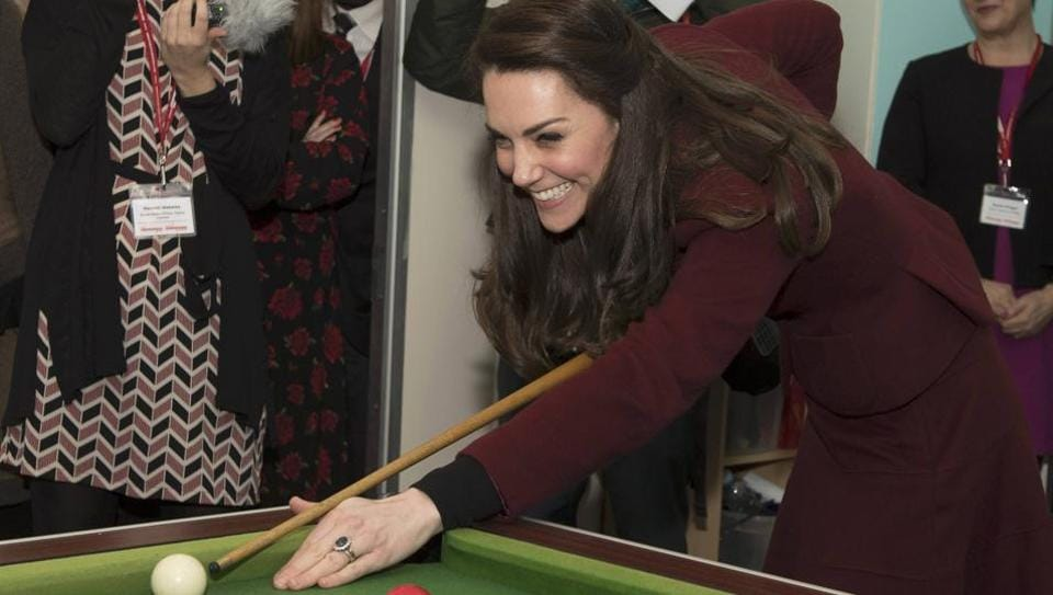 Britain's Catherine, Duchess of Cambridge, plays pool during her visit to MIST, a child and adolescent mental health project in Pontypool. (Paul Edwards / pool / REUTERS)